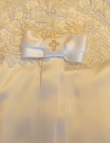 Doprosett med broderat kors