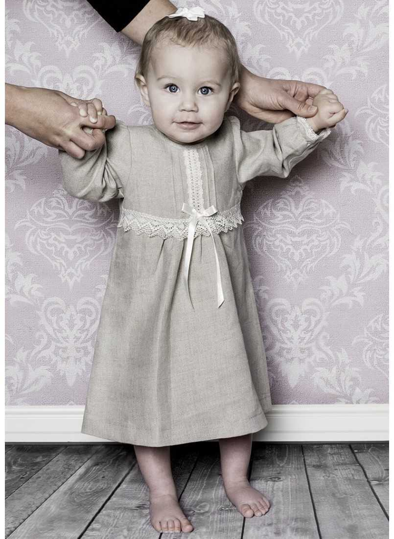Special occasion dress in linen with long sleeves and bow